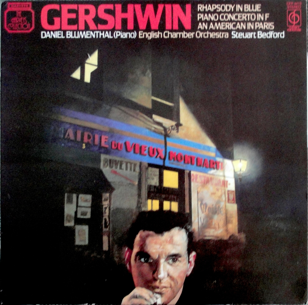 "The cover art for Music For Pleasure's 1983 album of Gershwin's ""Rhapsody in Blue/American in Paris"" LP."
